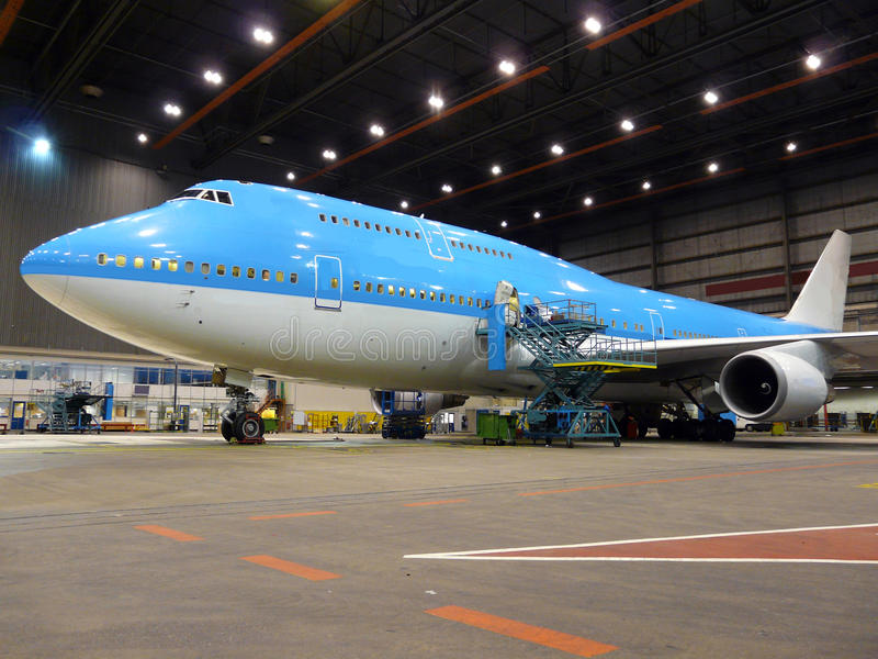 Airplane during maintenance stock photos
