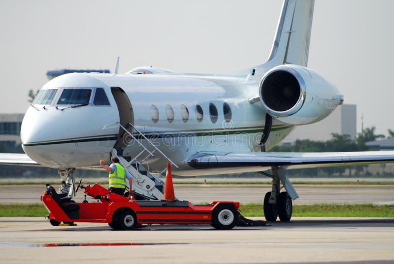 Airplane and maintenance crew stock photos