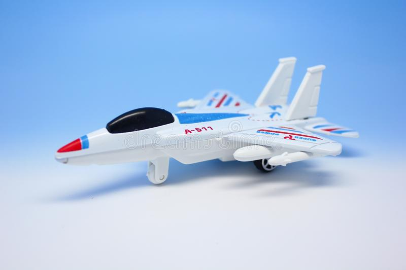 Airplane model. Close up of white plastic airplane model on blue background royalty free stock photo