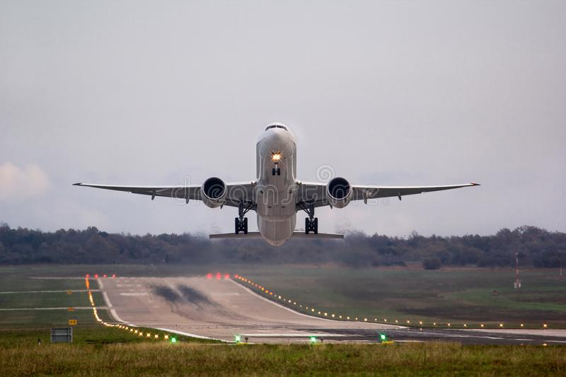 Airplane moments after takeoff, with beautiful environment royalty free stock photo