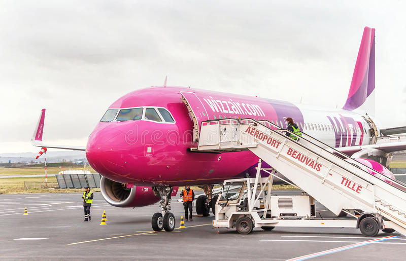 Airplane near the terminal gate ready for takeoff. stock image