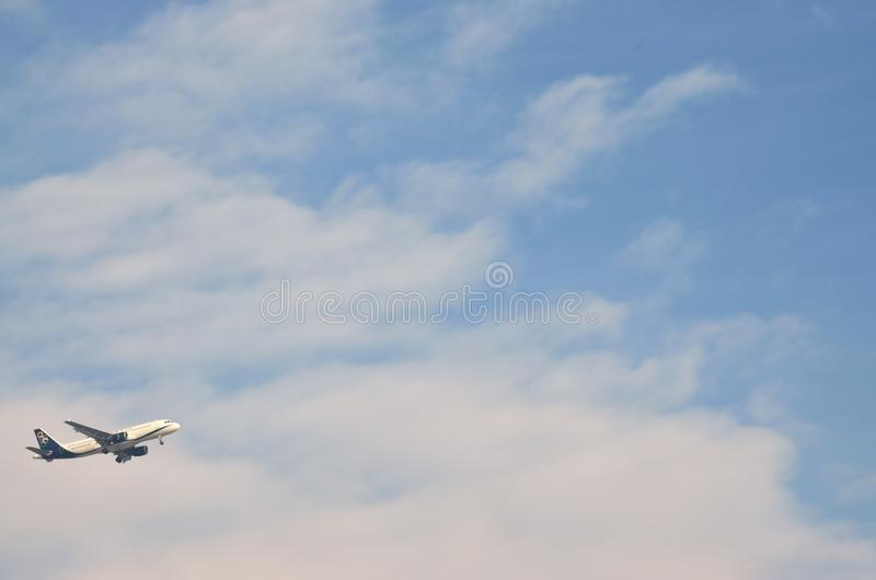 Airplane of Olympic air airlines flying in the air after  takes off from Macedonia airport in Thessaloniki, Greece. OLYMPIC AIR AIRLINES,THESSALONIKI/GREECE royalty free stock photography