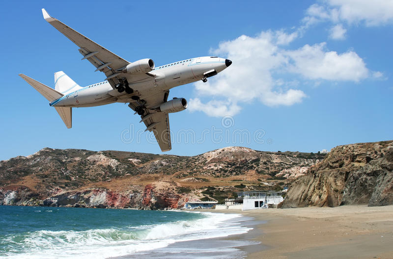 Airplane over the beach stock photo