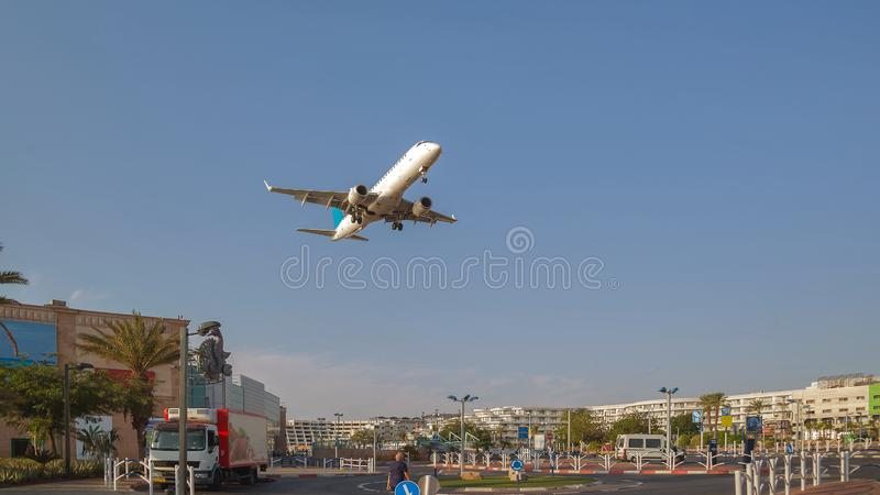 Airplane over the city of Eilat royalty free stock photo