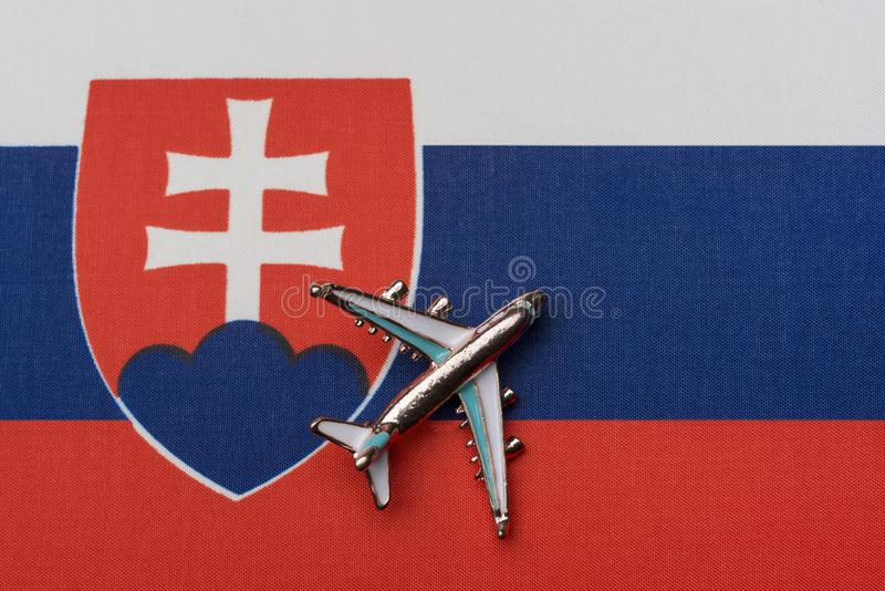 Airplane over the flag of Slovakia, the concept of travel royalty free stock photography
