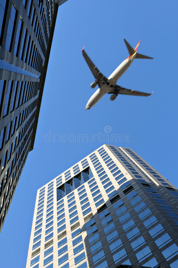 airplane over office building