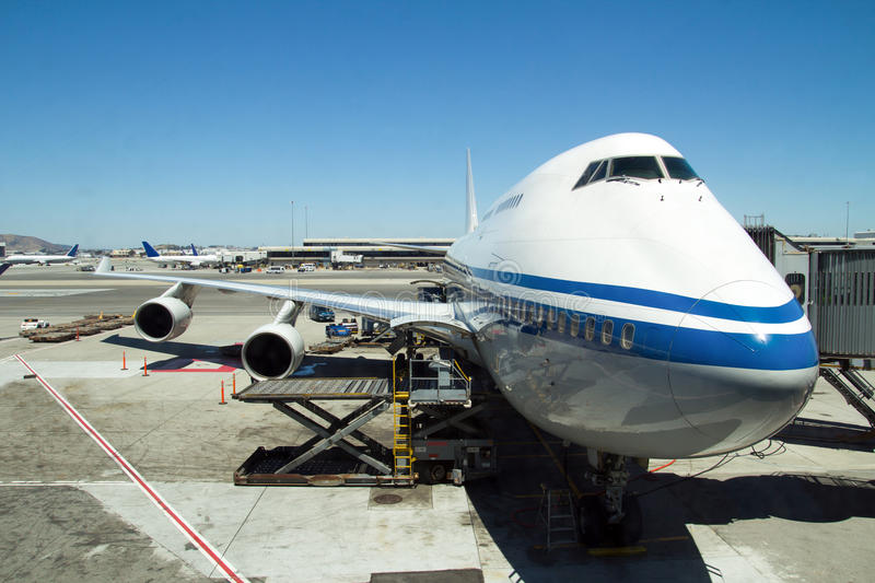Airplane Parked At The Airport Royalty Free Stock Photo