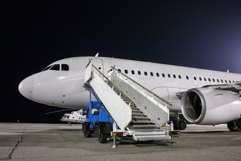 Download Airplane And Passenger Boarding Steps Vehicle At The Night Airport  Apron Stock Photo   Image