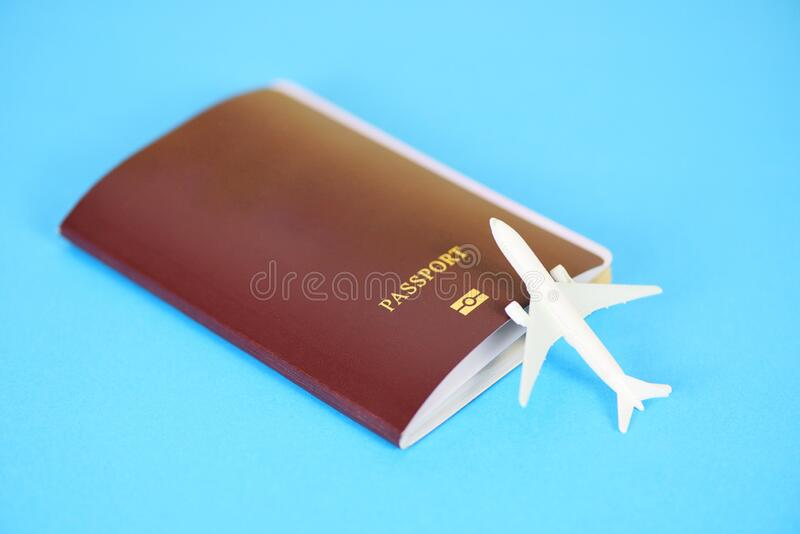 Airplane and passport flight travel traveller fly travelling citizenship air boarding pass travel business trip on blur background.  royalty free stock images