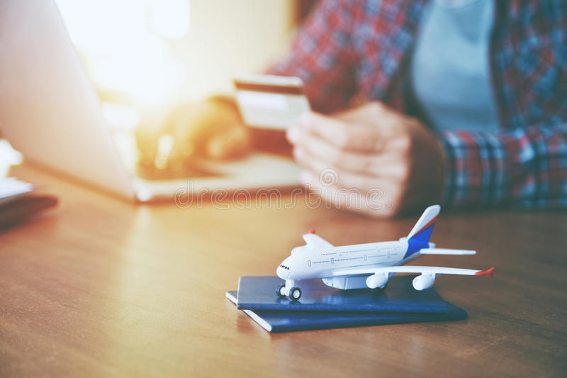 Airplane with passports near paying with credit card. And laptop. Online ticket booking concept stock images