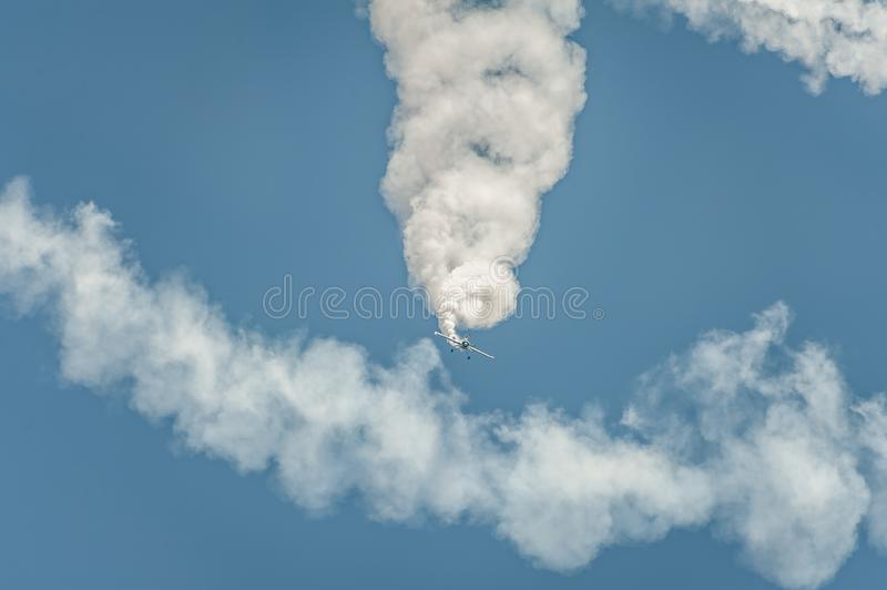 Airplane performing at airshow and shows a stunt royalty free stock images