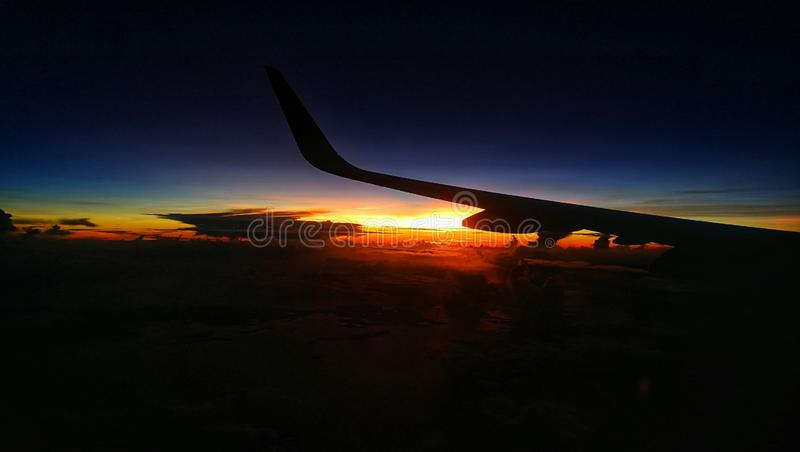Airplane Ride on a Sunset royalty free stock photography