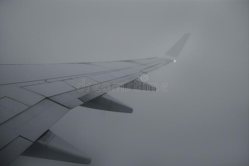 Download Airplane Right Wing Flying Over Cloudy Gray Day Stock Image - Image: 12220597