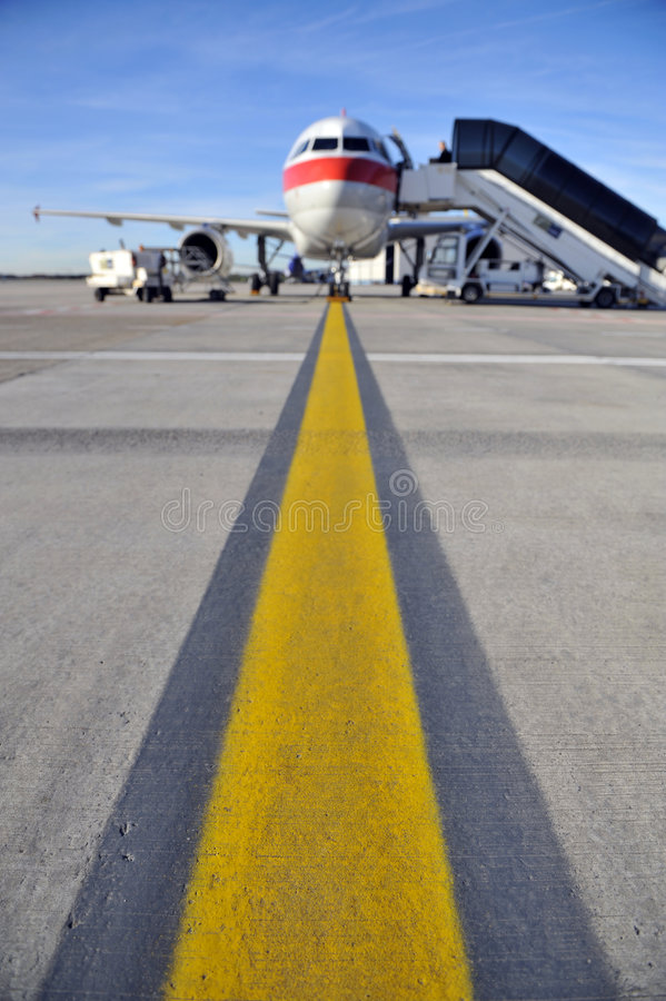Airplane on runway royalty free stock photo