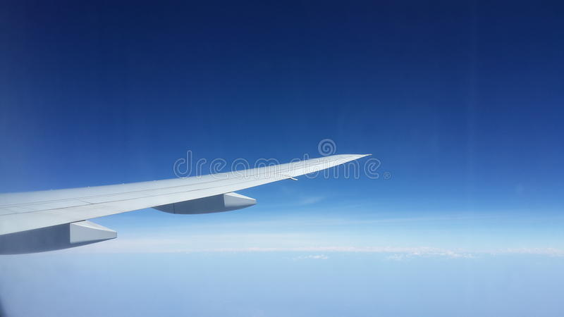 Airplane's wing in the air royalty free stock photo