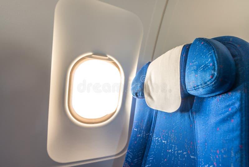 Airplane seat with white empty window stock photos