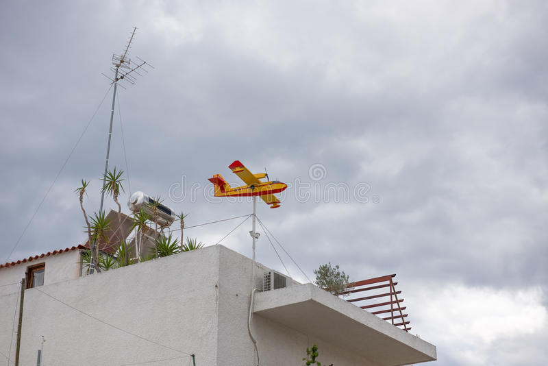 The airplane-shaped weather vane. At Aegina island in Greece stock images