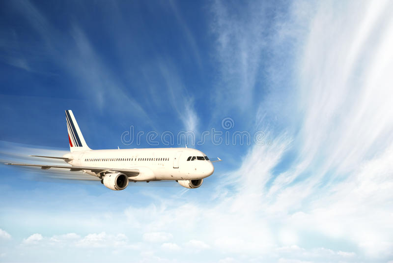 Airplane in the sky stock images