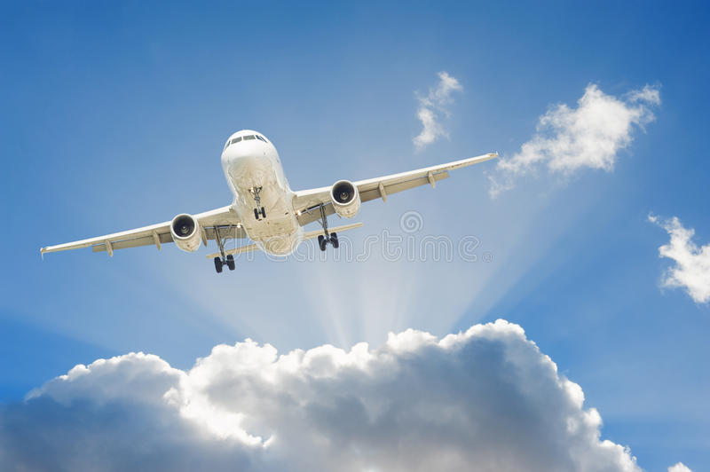 Airplane in the sky. Large passenger airplane flying in the blue sky royalty free stock images