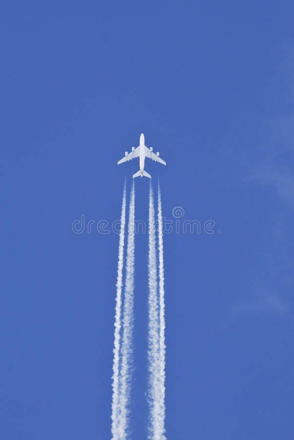 Airplane in the sky. White beautiful airplane in the sky, Airbus A380 royalty free stock photo