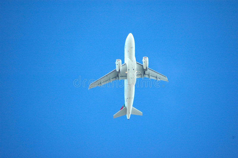 Airplane in the sky royalty free stock images