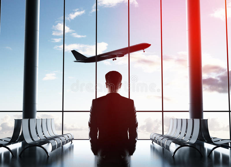 Airplane in sky. Businessman in airport looking to airplane in sky royalty free stock photography