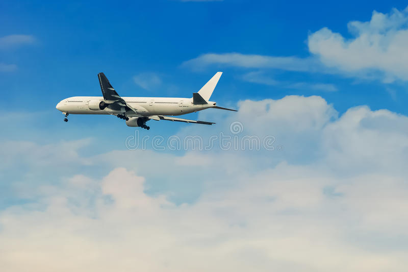 Airplane in The sky. A Flying airplane with blue sky background royalty free stock photo