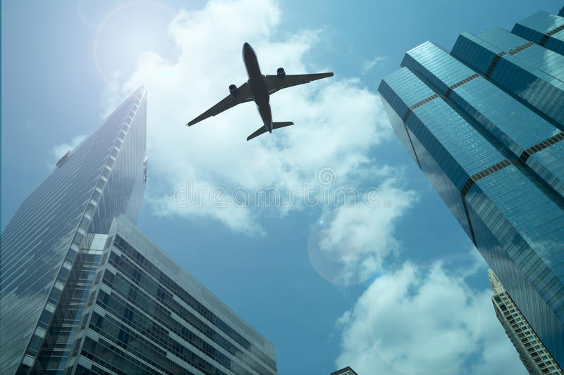 Airplane in the sky. With modern buildings stock photo