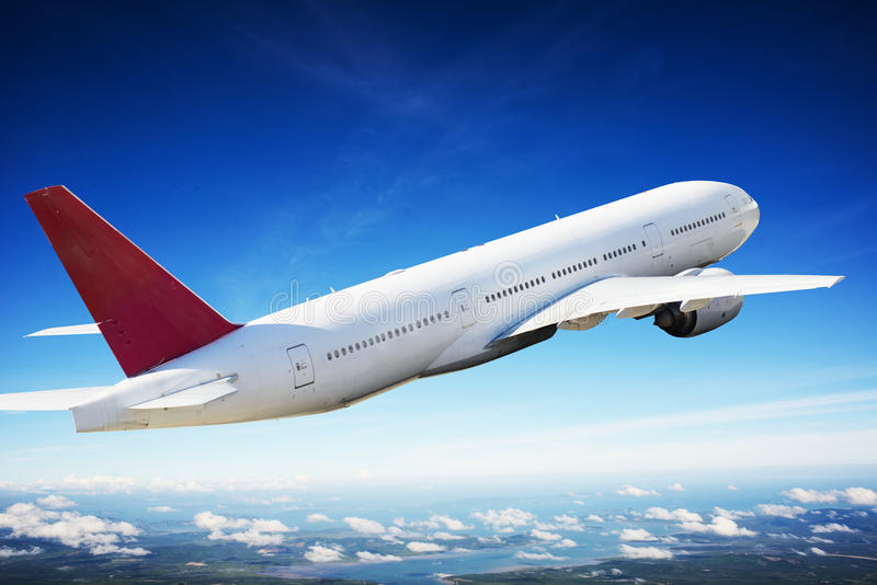 Airplane in the sky - Passenger Airliner / aircraft stock photos