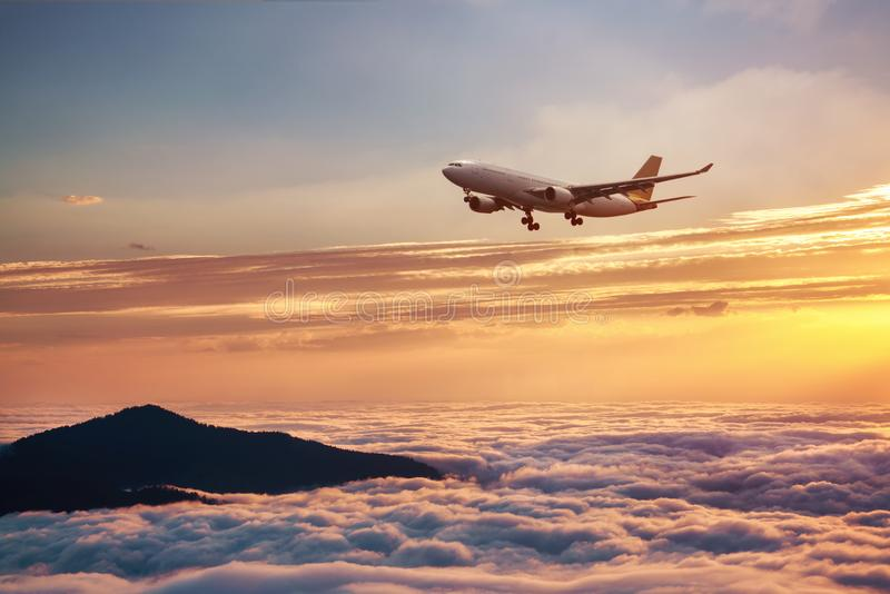 Airplane in the sky at sunset - Passenger Airliner aircraft stock photos