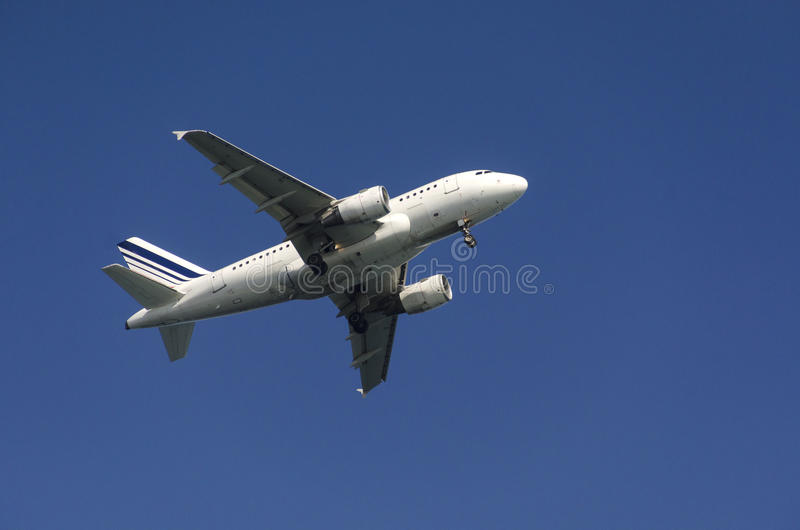 Airplane in the sky. Airplane taking off on a background blue sky royalty free stock photos