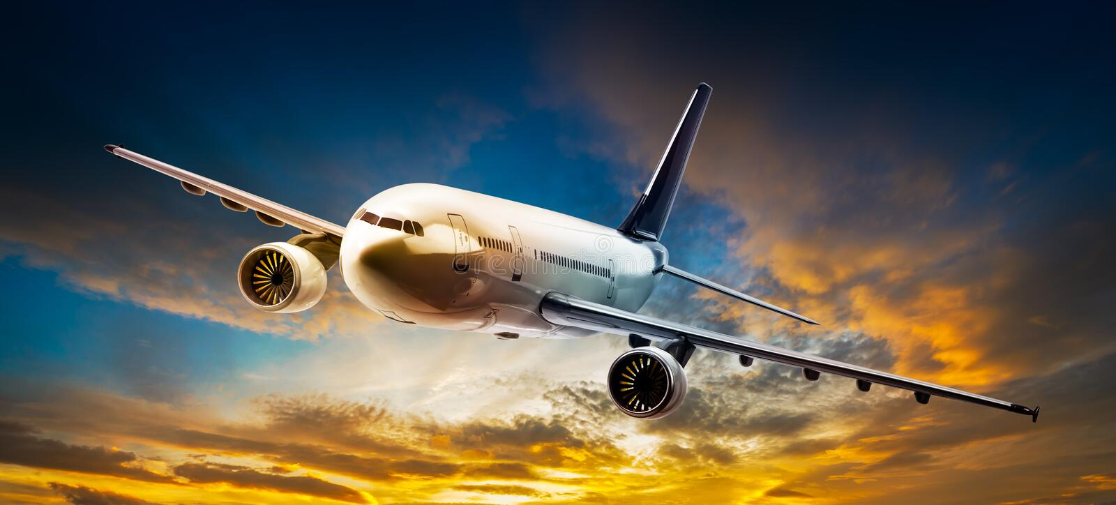 Airplane on the sky. Airplane for transportation flying on the sunset sky stock image