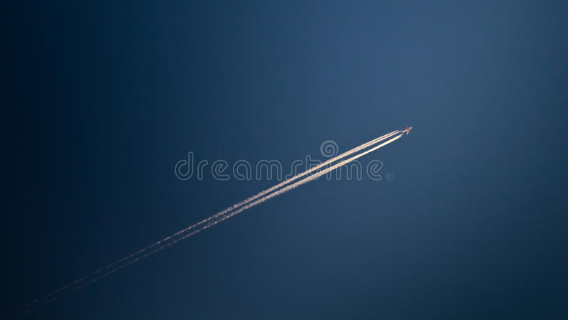 Airplane smoke trails royalty free stock photography