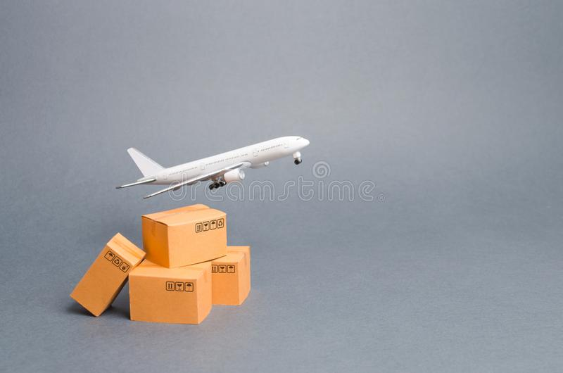 Airplane and stack of cardboard boxes. concept of air cargo and parcels, airmail. Fast delivery of goods and products. Cargo stock photo