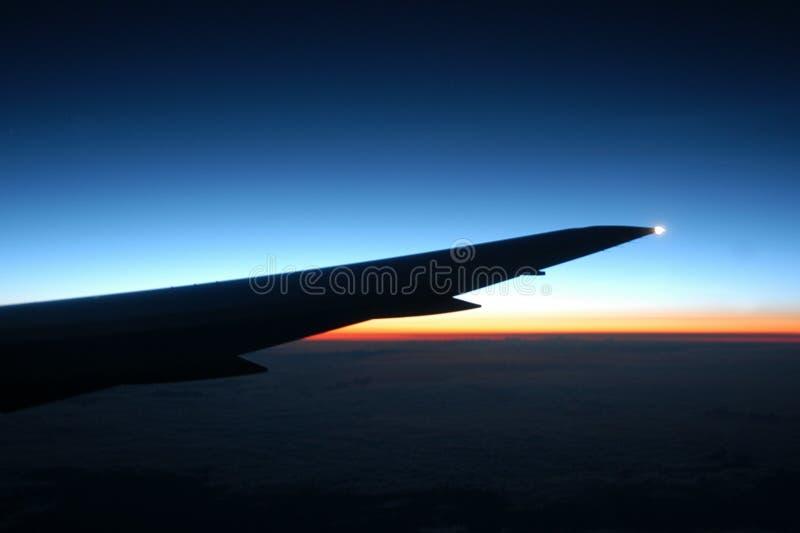 Airplane sunset royalty free stock image