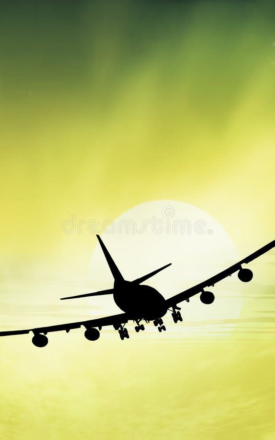 Airplane sunset green royalty free stock image