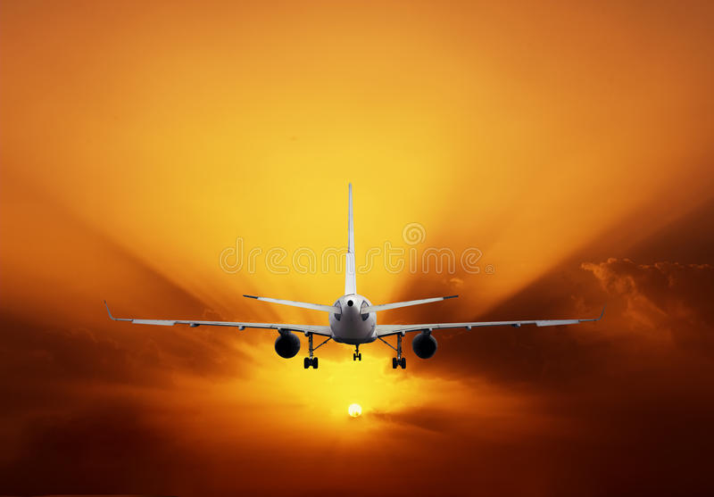 Airplane On Sunset Sky Royalty Free Stock Photos