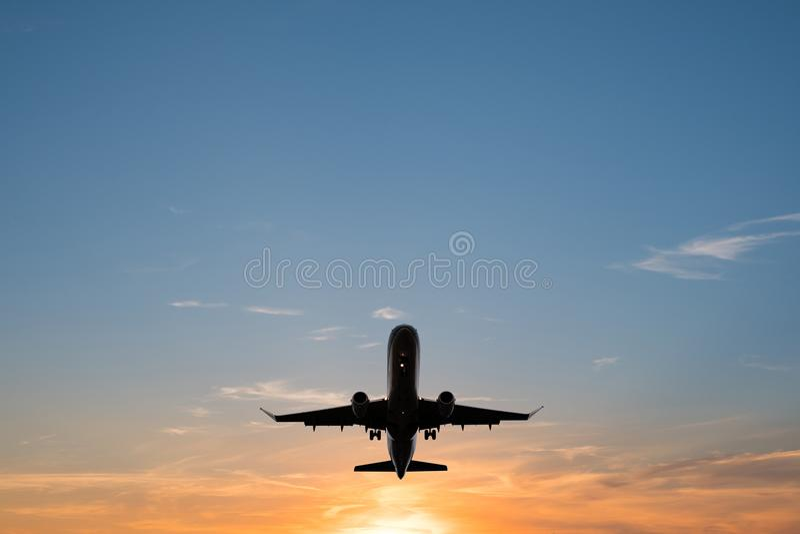 Airplane on sunset sky , aircraft silhouette scenic sky. Airplane on sunset sky - aircraft silhouette scenic sky stock photos