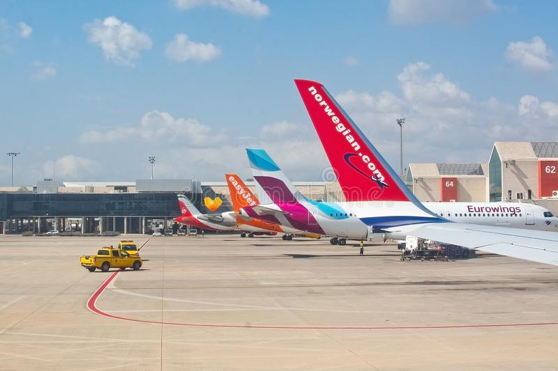 Airplane tail fins from Norwegian, Eurowings, Easyjet and more. PALMA DE MALLORCA, SPAIN - SEPTEMBER 6, 2018: Airplane tail fins from Norwegian, Eurowings stock photography