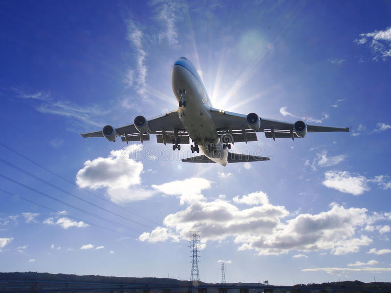 Airplane take off. Under sunlight royalty free stock photo