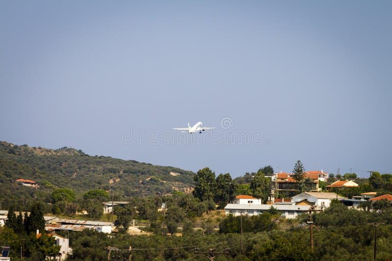 Airplane at take-off at Skiathos Airport royalty free stock images