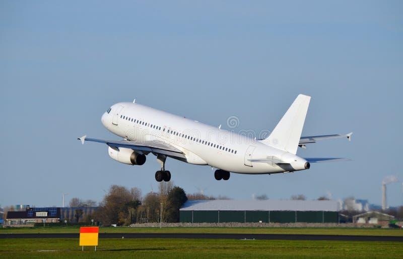 Airplane takes off stock photo