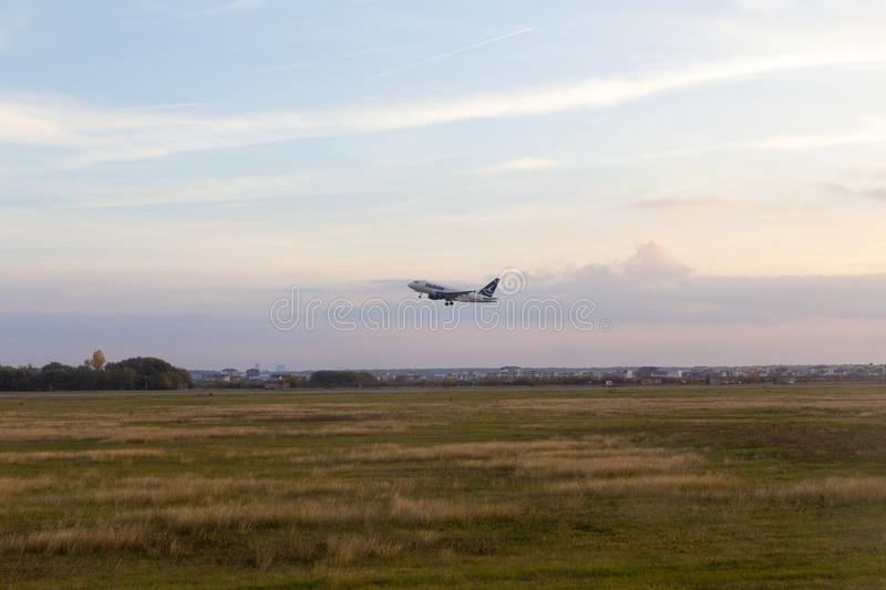 Airplane taking off from Bucharest international airport royalty free stock images