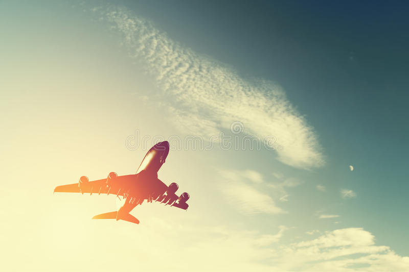Airplane taking off at sunset. royalty free stock photos
