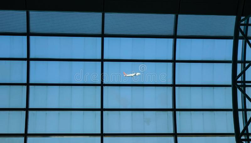 Airplane taking off, view from boarding gate. Jeju, South Korea - Sep 21, 2016. Airplane taking off, view from Boarding Gate of Jeju International Airport CJU stock photos
