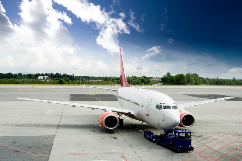Airplane on Tarmac. An airplane at the airport on the tarmac stock photography
