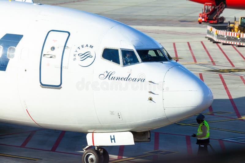 Airplane from Tarom stands near gate on airport Hamburg stock photo