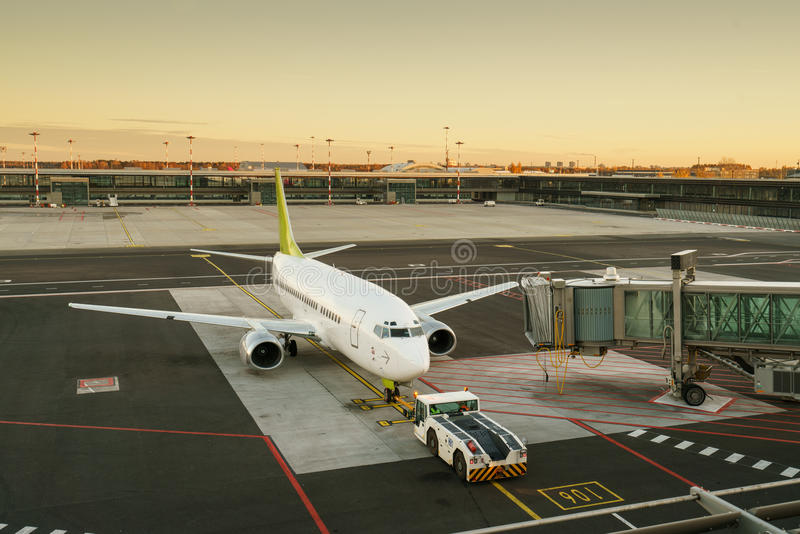 Airplane at the terminal gate ready for takeoff. International airport. stock images