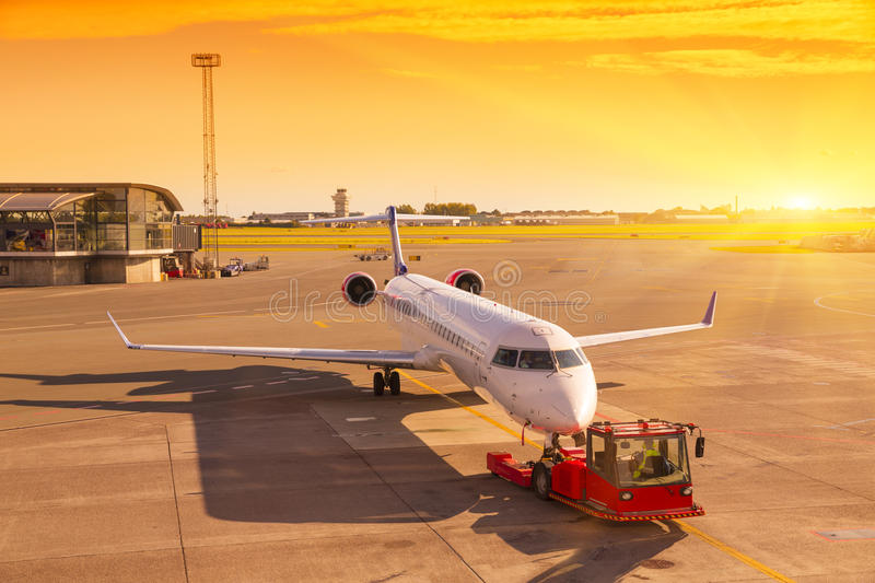 Airplane at the terminal gate ready for takeoff - Waiting for th royalty free stock photo