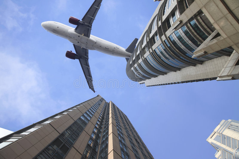 Airplane on the top of modern building. stock photography